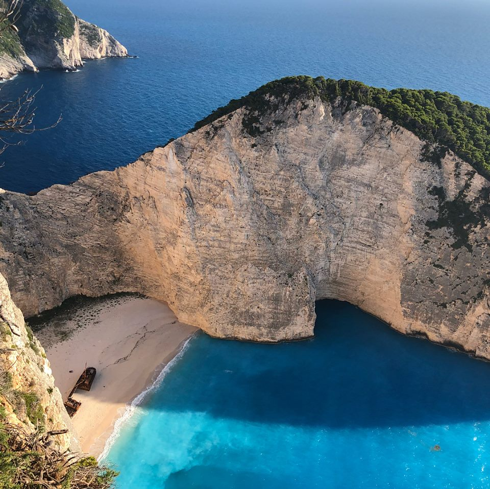 For the last leg of our trip, we picked a place we've never been, mostly because of the beach pics. Island in the Ionian, famous for the Shipwreck Navagio beach and blue caves. Evening views from top were way more impressive than daytime with the crowds.